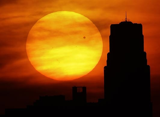 Venus is silhouetted as it crosses in front of the Sun