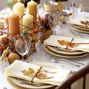 Thanksgiving table setting with leaves.