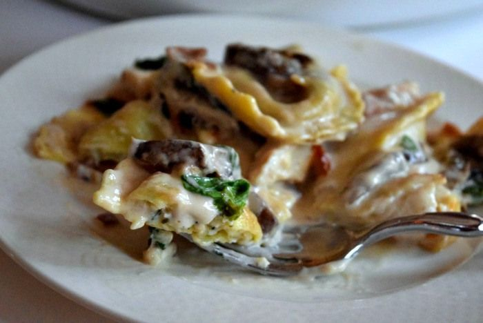 Creamy alfredo sauce, soft pillows of ravioli , spinach and mushrooms ...