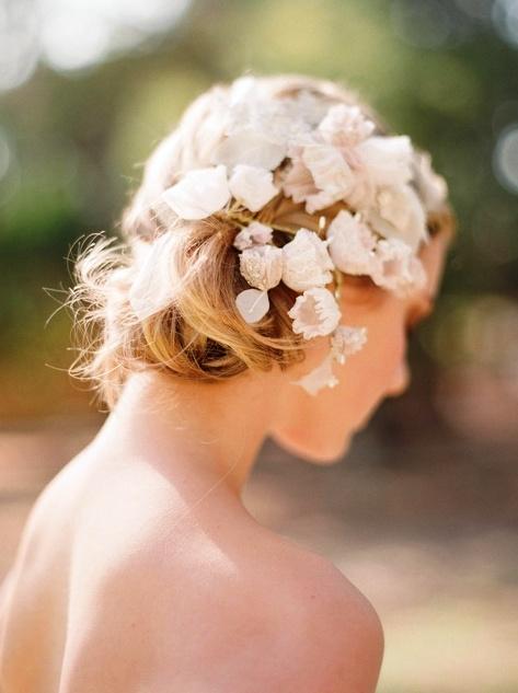 Bride's messy chignon bun bridal hair ideas Toni Kami Wedding Hairstyles ♥ ❶ wedding hairstyle with flowers crown halo corona