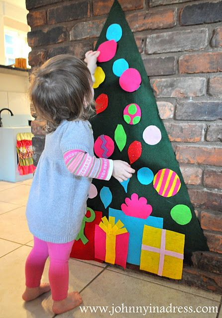 A felt tree for the baby to decorate and undecorate! Great idea - hopefully it keeps them away from the actual tree!