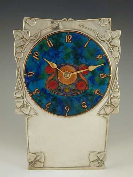 archibald knox, liberty & co - pewter & enamelled dial, 1905 england