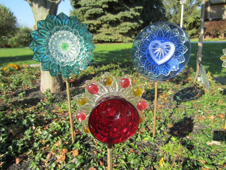 Pin by marcy stafford on glass flowers garden totems for Garden art from old dishes