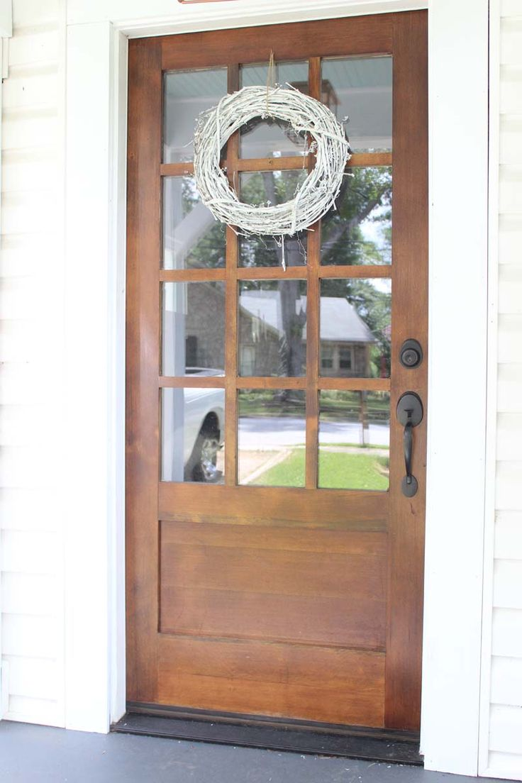 Our new front door dark stained wood with white for New wooden front door