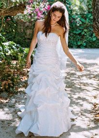 """A new twist on a traditional favorite. A fresh take on the art of the """"pick-up"""",texture and dimension create an amazing story on this romantic wedding dress.   Gown features pick up swirl skirt and empire waist with beaded applique detailing.  Construction of gown and applique placement creates the illusion of long legs while ruching flatters the waist.  Sweep train. Sizes 0-16. Available in stores and online inWhite.Ivory available in stores by special order.  Petite: Style 7WG3397,  Siz..."""