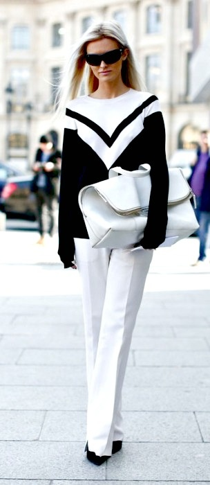 monochrome gorgeousness carrying her clutch victoria beckham style