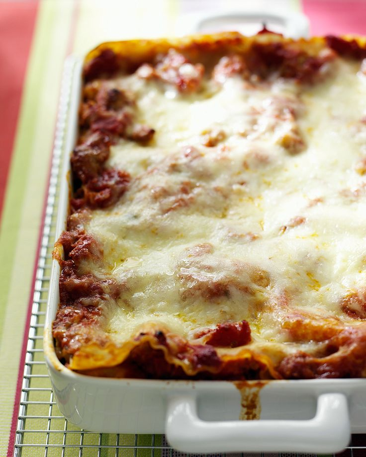 Tomato-Sausage Lasagna === Soaking the noodles in hot tap water (while ...