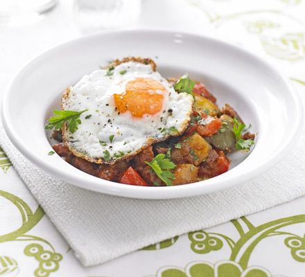 Potato, pepper & chorizo stew with fried eggs | BBC Good Food