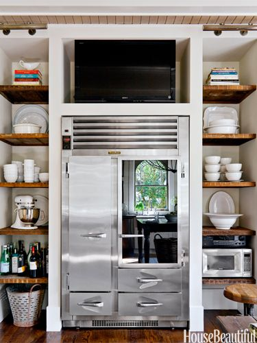 Open shelves, Fridge, Tv.  Hmmm....the perfect kitchen for me!
