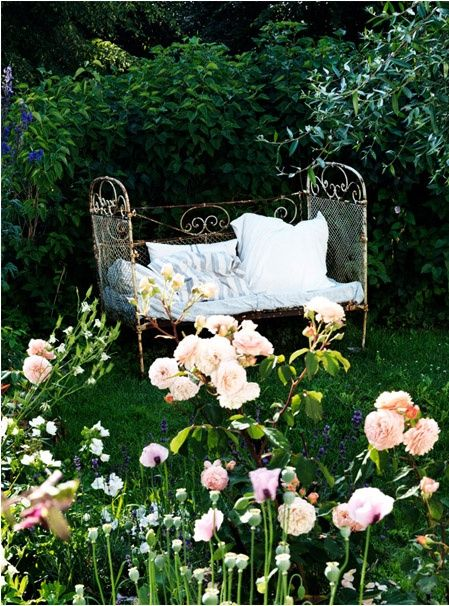 #shabby #bench made from an old #cot in a pretty little #garden.