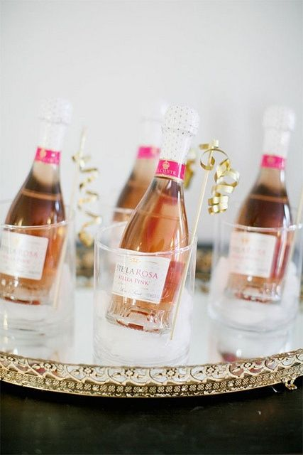 Mini champagne bottles.