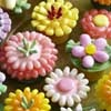 Turn ordinary cupcakes into spring flowers with easy decorating tips to make Spring Flower Cupcakes, using mini candies like jelly beans, Jordan almonds, licorice and more. Perfect for showers, weddings, Easter, graduation or any party.