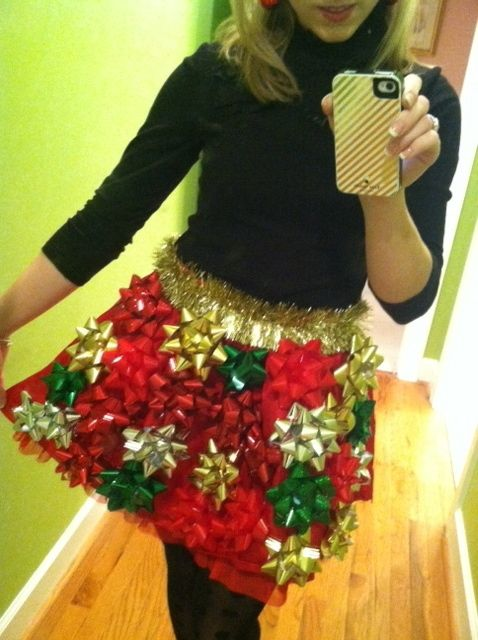 Got an ugly Christmas sweater party to go to? Hot glue tinsel and gift bows to make something spectacularly tacky.