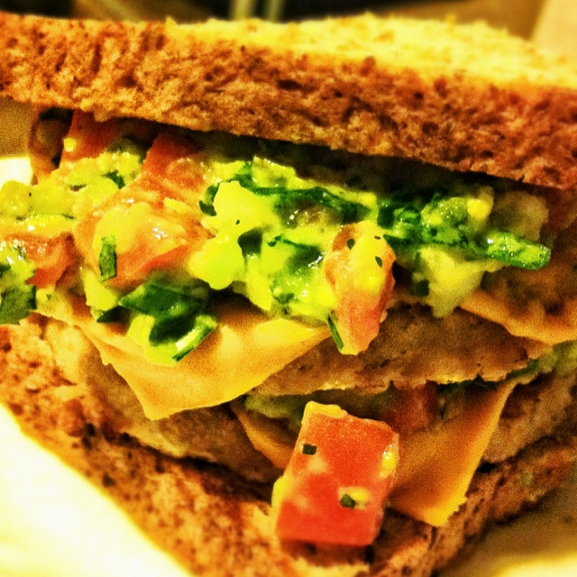 Boca Vegan cheeseburger with guacamole on sprouted grain bread.