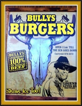 """Bully's Burgers -- This roadside burger stand is the real deal. Set on the Triple L Ranch with herds of cattle leisurely roaming past, its location let's you see exactly where your juicy 6oz. -10oz. 100% Maui beef burger came from. Bully's was the brainchild of the late Louis """"Bully"""" De Ponte, a champion bullrider and rancher, and his wife artist Paige De Ponte. After Bully's death, Paige carried out their plans, and she's keeping it a family affair with their son Zach manning the grill."""