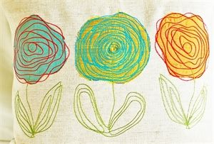 Scribbled Roses applique design.  Couch yarn to make flowers.