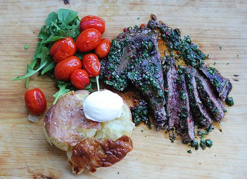 Skirt steak with roasted cherry tomatoes and crushed potatoes