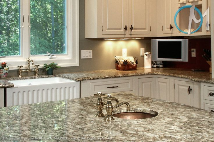 Giallo ornamental used with the white cabinets always makes for a