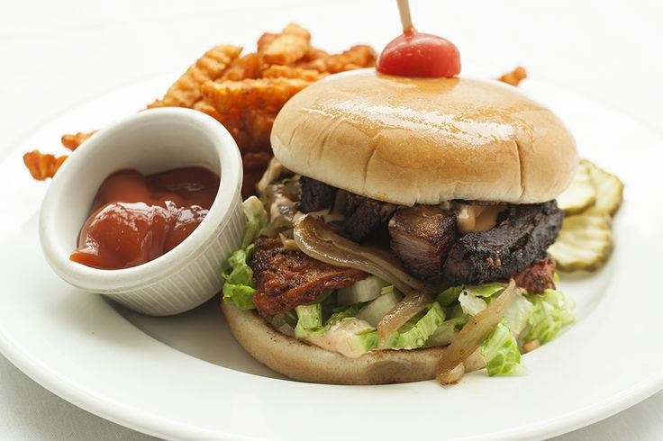 Crispy Wild Boar Belly Sandwich at Crocker Cafe by Supper Club: blackened tomato, grilled onions, shredded lettuce, creole aioli, on burger bun served with sweet potato fries