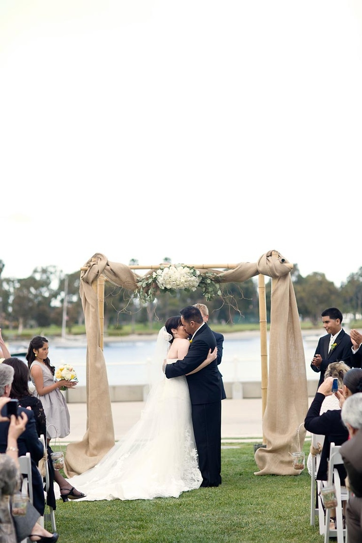 chuppah- how about natural wood, dark stained wood, or antiqued wood with tulle draped like this