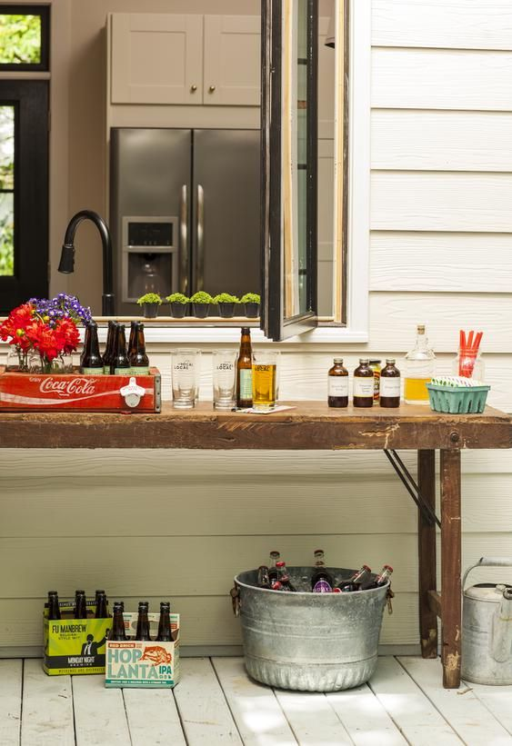"This cool ""pass-through"" window makes setting up an outdoor party from the kitchen easy and fun. I want one!"