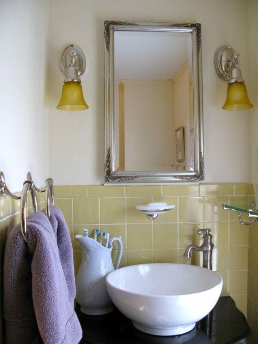 Yellow tile bathroom makeover chris house thinkies for Yellow bathroom ideas pinterest