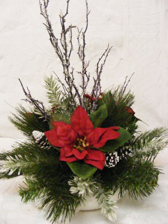 Lotus bowl christmas arrangement winter arrangement for Poinsettia arrangements