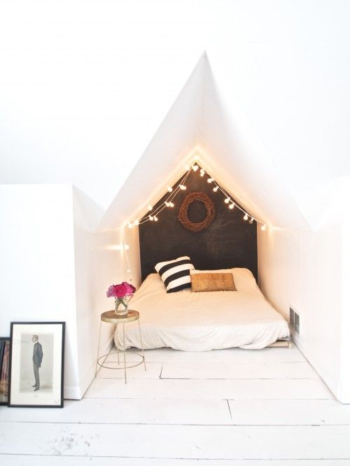 "Design*Sponge Sneak Peek: The nook"": This is our wee little guest room (well, I may have taken a few naps in there as well.) The back wall is Krylon chalkboard paint with rubbed chalk. The lights are from Target and the bed is Ikea."