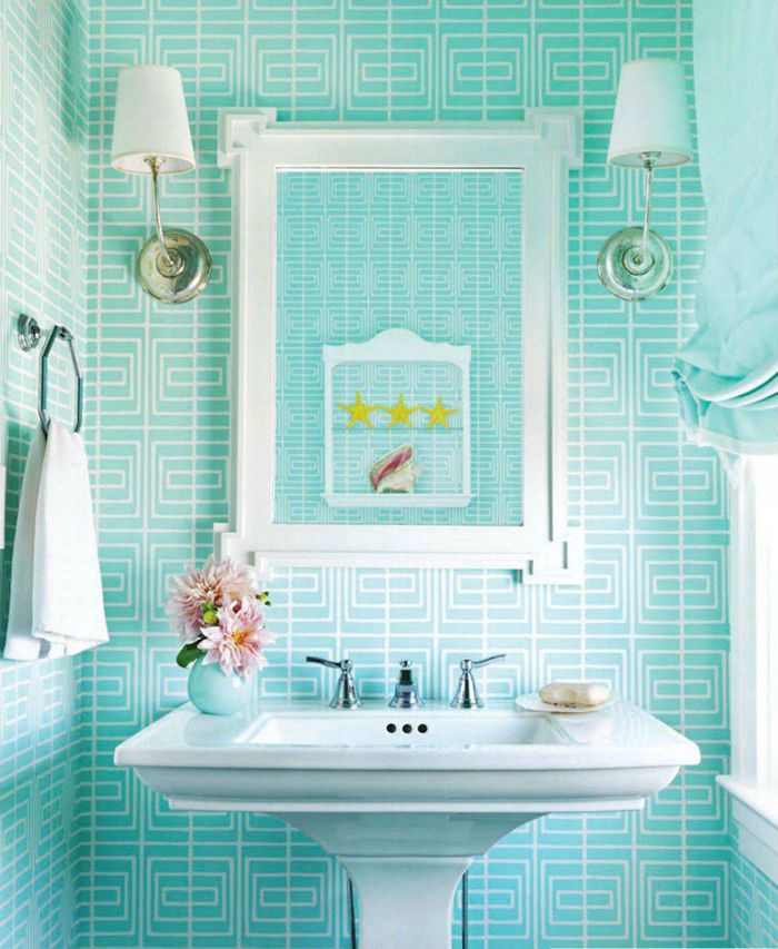 wallpaper, or you could get a similar look with aqua subway tiles