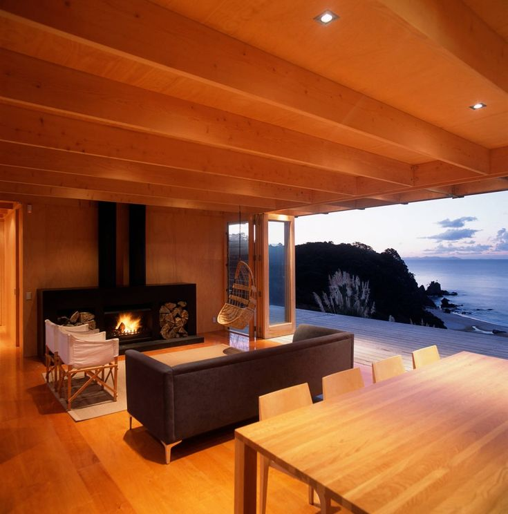 wooden living room with a fireplace
