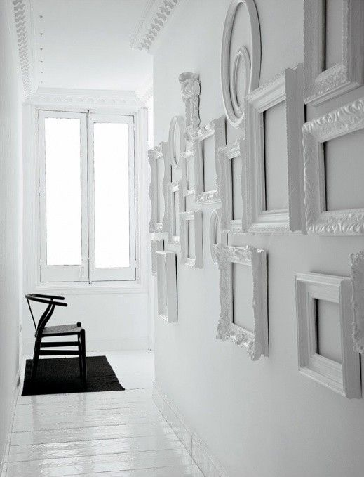 Decorating with white.  White frames galore!  <3