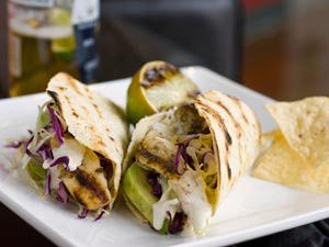 Hot-off-the-grill cilantro-lime marinated red snapper fish tacos are ...