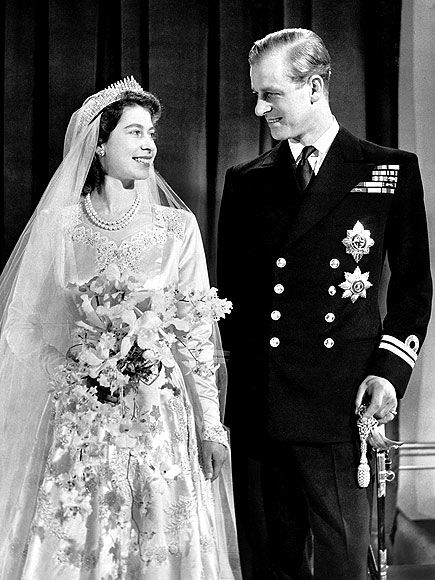 Princess Elizabeth beams at her new husband, Philip Mountbatten, on their wedding day on Nov. 20, 1947. Philip, Elizabeth's distant cousin, had been Prince Philip of Greece and Denmark but renounced his titles and any claims to foreign thrones before marrying the English princess. Some 200 million people around the world listened to the BBC radio broadcast of the wedding.
