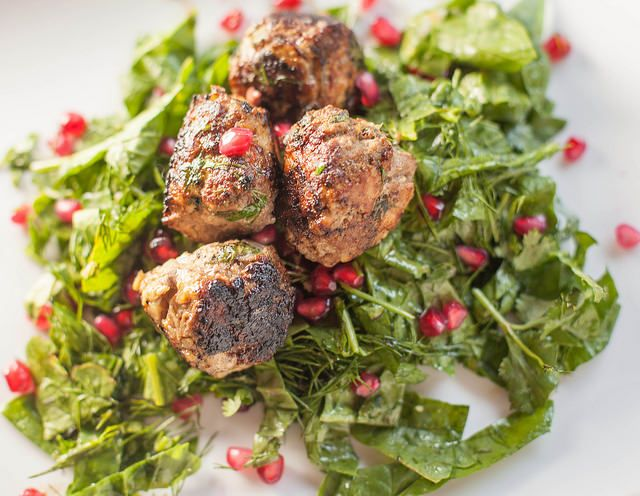 chicken + beef koftas with spinach, pomegranate, dill + cilantro salad