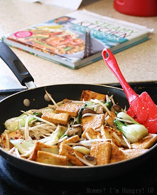 Crispy tofu with rice noodles and veggies in spicy soy sauce