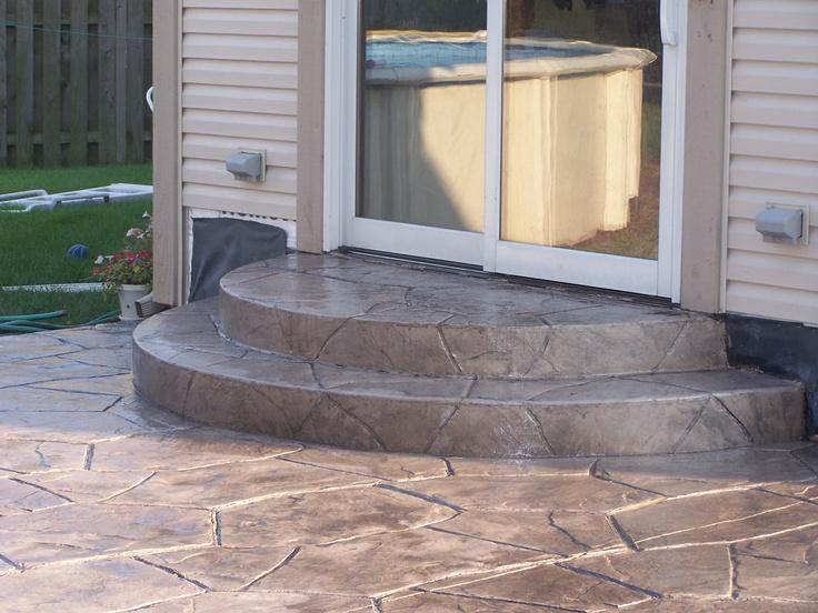 steps from high patio door garden