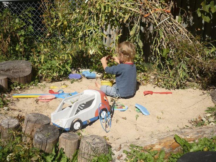 Backyard Sandpit : backyard sandpit bordered by stumps  Backyard Ideas  Pinterest