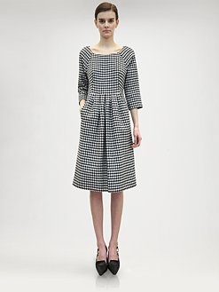 A traditional menswear treatment gets the feminine touch. Jil Sander - Wool Houndstooth Dress