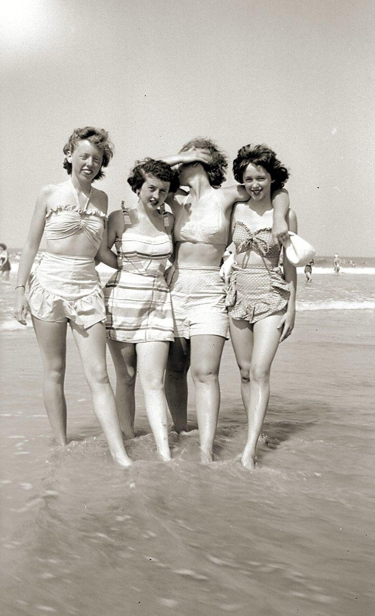Teen girlfriends enjoying a day at the beach, 1940s.