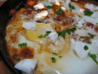 Shakshouka (eggs poached in a sauce of tomatoes, chili peppers, onions ...