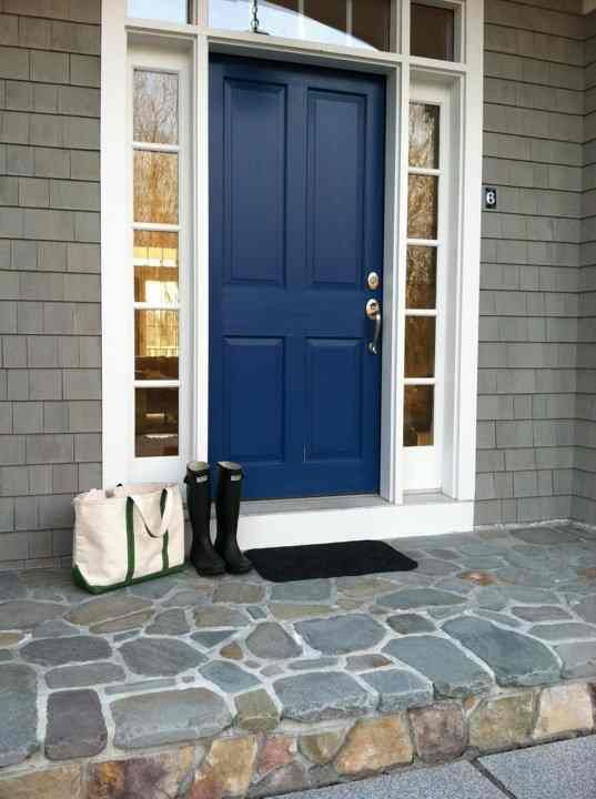 Front door. gray house, nautical blue door