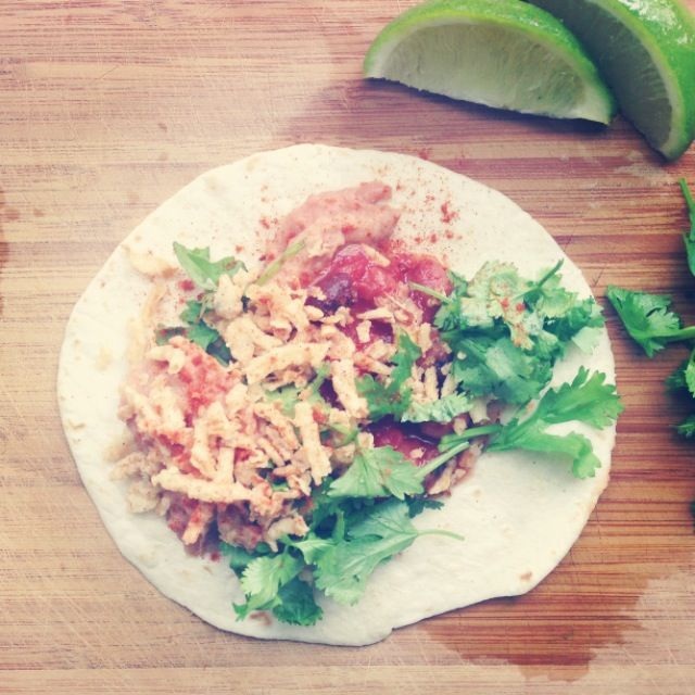 Refried beans, pineapple salsa, fried onions, cilantro and lime on a ...