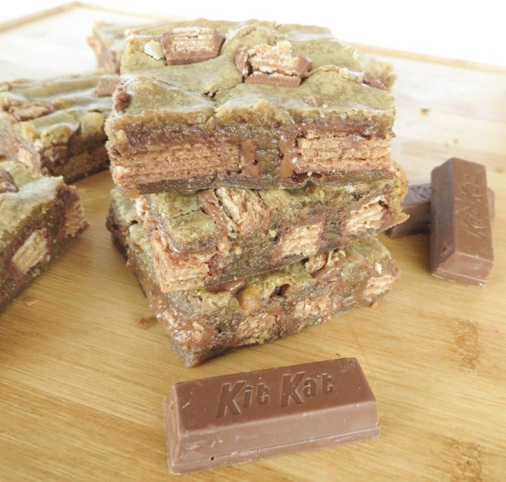 Gooey Kit Kat Blondies. Your favorite candy bar stuffed into a buttery ...