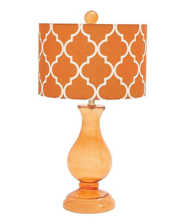 This orange teardrop glass table lamp by uma enterprises is perfect