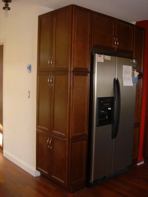 longer pantry cabinet next to fridge for the home