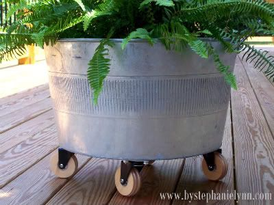 Metal planter on the cutest wheels.  Lots of other options for this moveable container too now that I think about it.