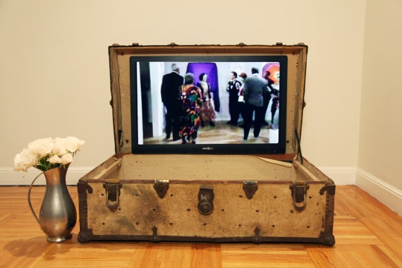 trunk with a tv embedded inside the lid