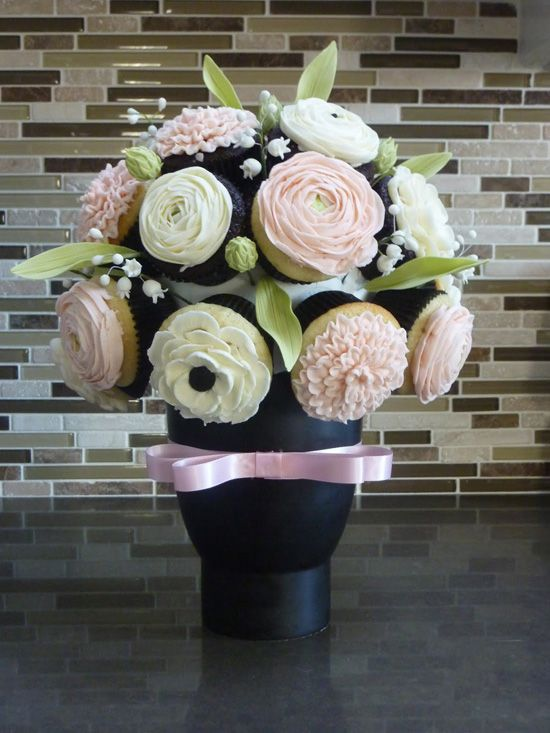 The floral cupcake bouquet can be used as a wedding or shower centerpiece and dessert too!