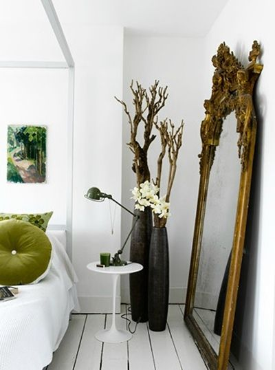 gorgeous antique gold mirror in a modern bedroom