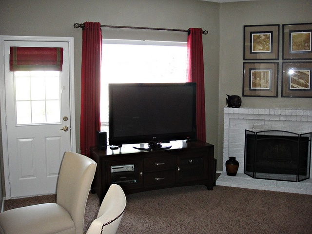 Draperies with grommets and roman shade furnished and installed by Kite's Interiors.